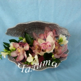 An arrangement of orchids, freesia, greenery. Price: 47 USD