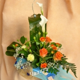 An arrangement in the shape of a sailer of roses, carnations, callas, chrysanthemums. Price: 41 USD