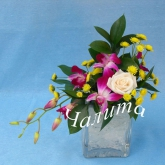 An arrangement on a floral foam of rose, orchid, chrysanthemum in a vase with the effect of ice. Price: 24 USD