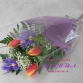A bouquet of tulips and irises with assorted greenery and organza. Price: 22 USD