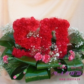 An arrangement for anniversary in the shape of numbers made of natural carnations with assorted greenery. Price: 73 USD