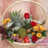 A gift basket with flowers and lots of exotic fruits. Price: 58 USD