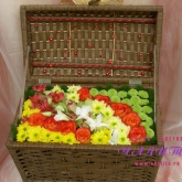 An arrangement of roses, orchids, chrysanthemum and alstroemeria in a box. Price: 105 USD