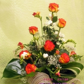 An arrangement of roses, freesia, chrysanthemum and assorted greenery. Price: 51 USD