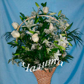 A gift basket of white lilies, roses, baby's breath and assorted greenery.  Price: 69 USD