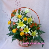 A gift basket of lilies, roses, alstroemeria and greenery. Price: 51 USD