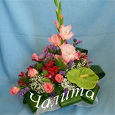 An arrangement of lots of bright summer flowers  and assorted greenery. Price: 49 USD