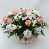 Basket of flowers from roses, freesia and chrysanthemums. Price: 83 USD