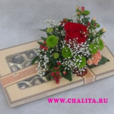 A box of sweets decorated with an arrangement of natural flowers. Price: 27 USD