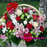 A basket of lots of flowers and assorted greenery. Price: 169 USD