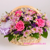A basket of 7 pink roses and other flowers and greens. Price: 64 USD