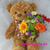 A big teddy-bear with a bouquet of natural flowers. Price: 66 USD