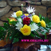 A flower arrangement of roses, chrysanthemum, statice and greenery. Price: 31 USD