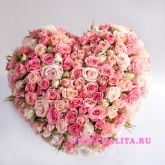 Heart form flower arrangement of roses. Price: 85 USD
