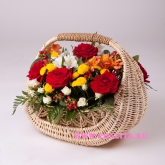 Basket with roses, carnations, alstroemeria and hypericum. Price: 85 USD