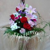 A bouquet of roses, lilies, chrysanthemums and other  flowers with assorted greenery. Price: 61 USD