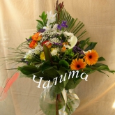 A bouquet of roses, gerbera diasies, irises, callas and many other flowers.  Price: 69 USD
