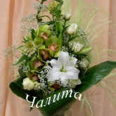 A bouquet of orchid cymbidium, lilies, roses and other flowers with assorted greenery. Price: 66 USD