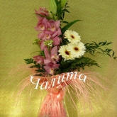 A bouquet of orchid cymbidium, lilies, gerbera diasies and  ornithogalums with assorted greenery.  Price: 53 USD