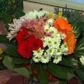 A round-shaped bouquet of a great number of different flowers.  Price: 52 USD