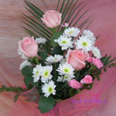 A bouquet of pink roses, chrysanthemums, carnations and greenery.Price: 32 USD