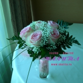 A bouquet of 5 roses and baby's breath with assorted greenery.Price: 28 USD
