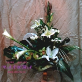 A bouquet of lilies, orchids, callas and other flowers decorated with greenery. Price: 69 USD