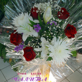 A bouquet of lilies and roses with addition of other flowers and assorted greenery.Price: 44 USD