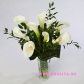 Bouquet of 9 white callas and decorative greenery.Price: 73 USD