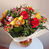 Bouquet of roses, orchids and other greens Price: 47 USD