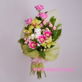 A bouquet of pink roses and other flowers with a small teddy bear Price: 47 USD