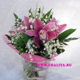 A round-shaped bouquet of orchids and lilies-of the-valley. Price: 171 USD
