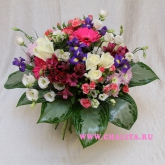 A round-shaped delicate bouquet  of many flowers and calathea leaves. Price: 77 USD