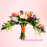 Unusual shape of the bouquet of spring flowers and roses. Price: 52 USD