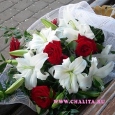 Bouquet of white lilies, purple roses and decorative greens.Price: 62 USD