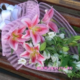 A bouquet of lilies and lisianthus. Price: 53 USD