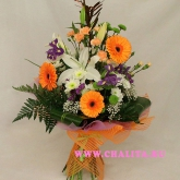 A bouquet of gerbera diasies, lilies and many other flowers and assorted greenery. Price: 50 USD