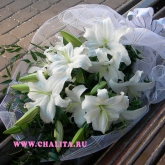 A bouquet of lilies and assorted greenery. Price: 53 USD