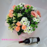 A bouquet of roses, gerbera diasies, alstroemeria and chrysanthemum with a bottle of wine.   Price: 85 USD