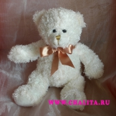 A small teddy-bear - 17 cm,  is a nice addition to a bouquet. Price: 3 USD